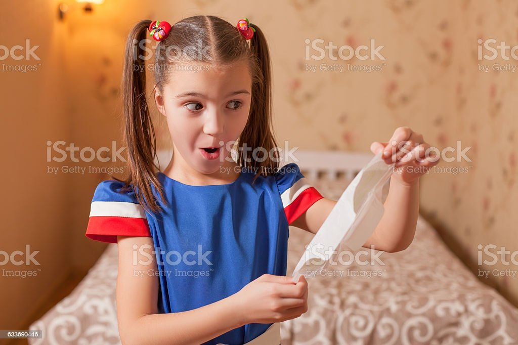 Kid has found panty liners. stock photo