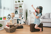 istock kid holding a megaphone and raising a hand 1040824884