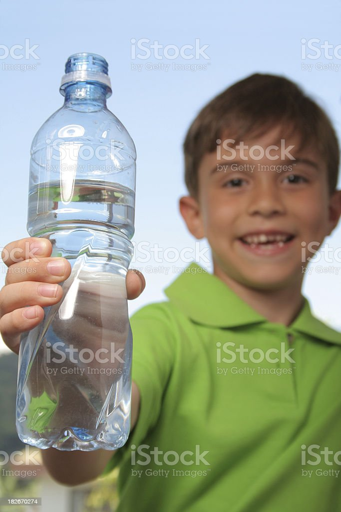 Kid holding a water bottle stock photo