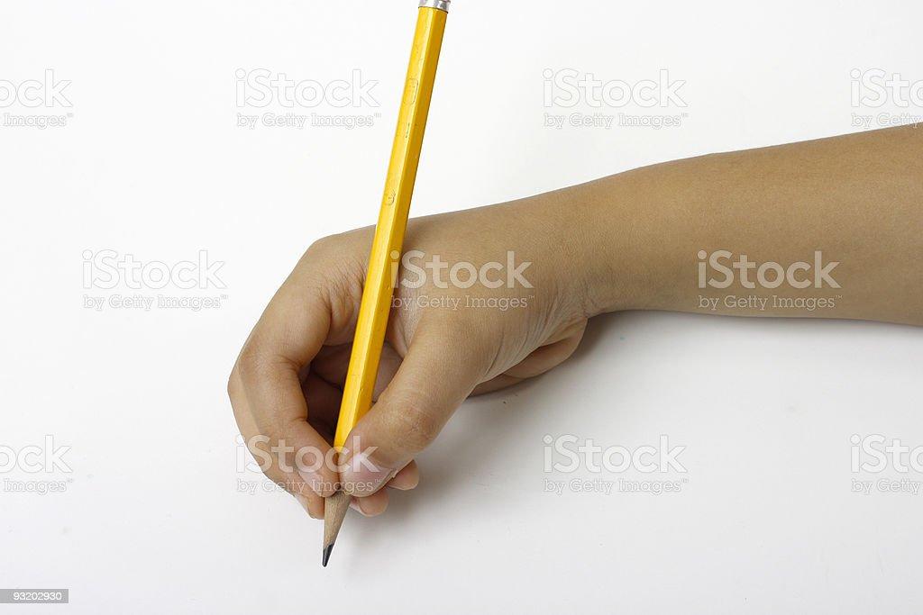 Kid holding pencil stock photo