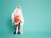 istock kid in ghost costume 1170511057