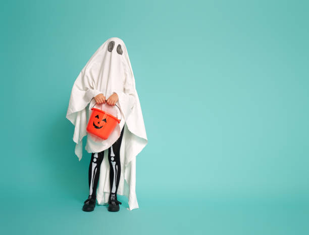 kid in ghost costume stock photo