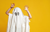 istock kid in ghost costume 1170511066