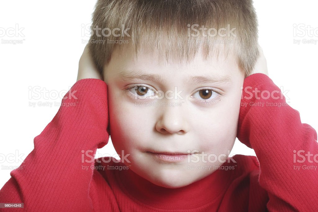 Kid in red closing ears royalty-free stock photo