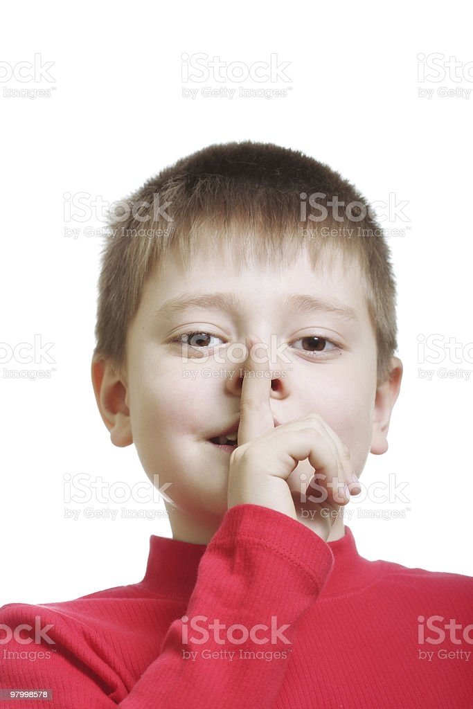 Kid in red gesturing hush sign royalty free stockfoto
