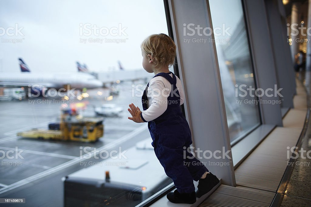 Kid in the airport. stock photo