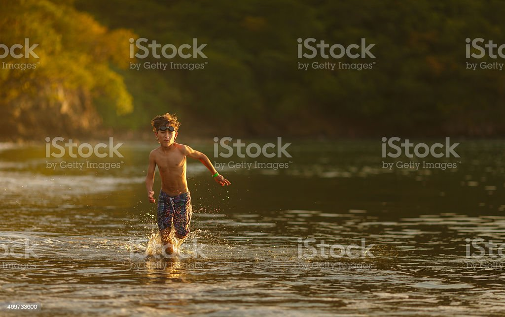Kid in the beach stock photo