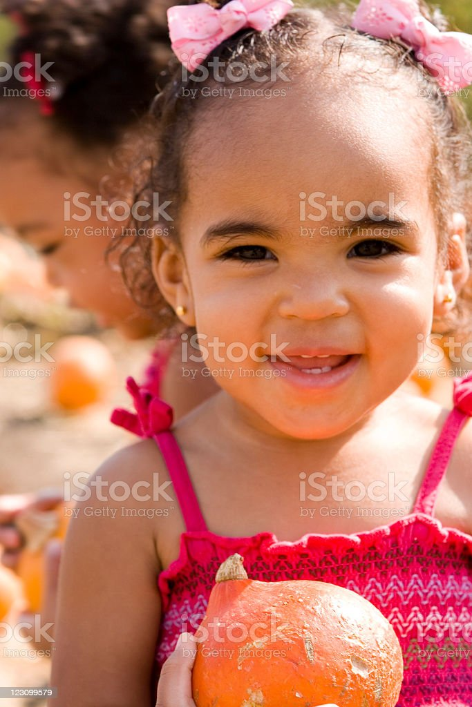 Kid in the pumpkin patch stock photo