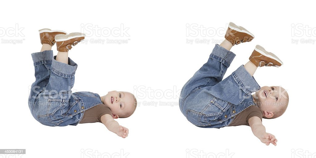 kid is lying with lifted legs royalty-free stock photo