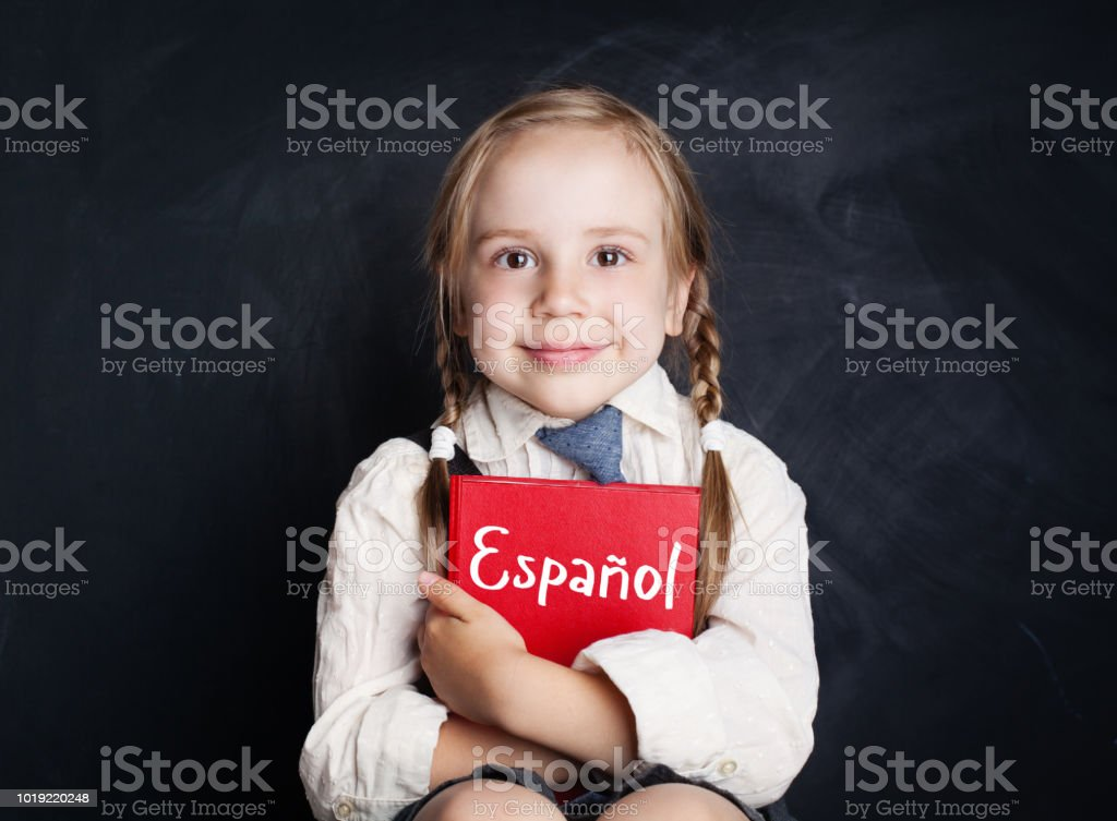 Kid Learning Spanish Little Girl With Spanish Book Stock