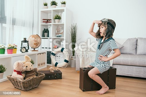 kid looking at somewhere else. she thinks she's a real pilot