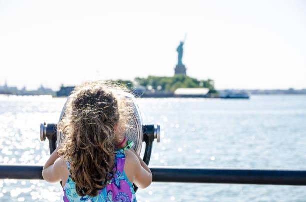 Kid looking at Statue of Liberty