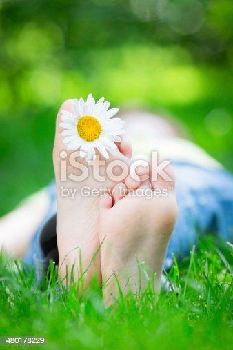 480122543 istock photo Kid lying on grass 480178229