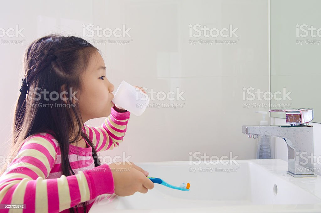 kid mouth rinse stock photo