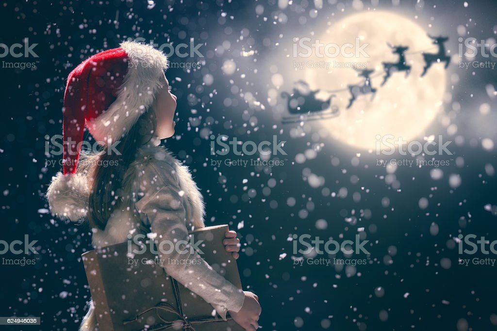 kid on dark background stock photo
