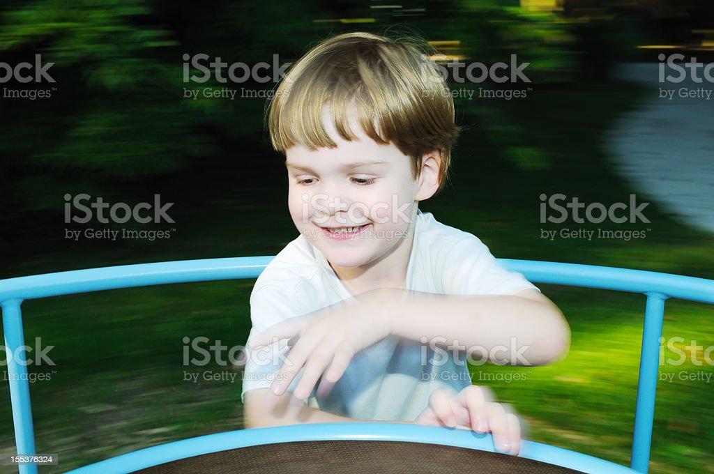 Kid on the merry-go-round royalty-free stock photo