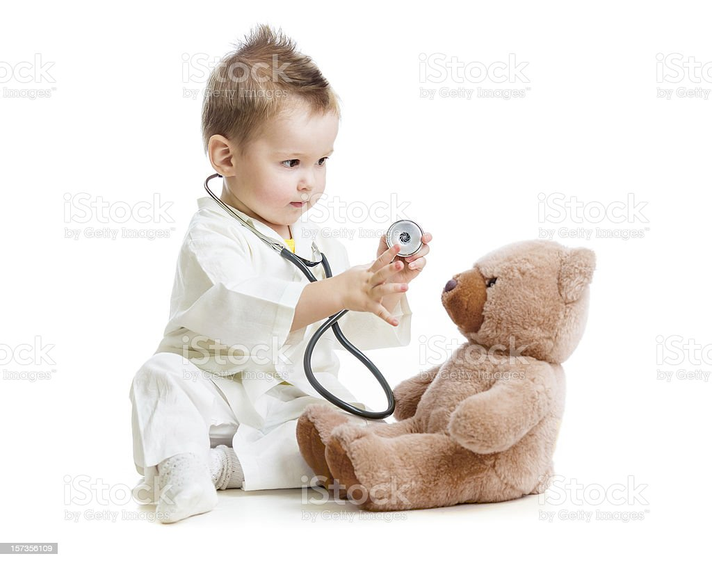 kid or child playing doctor with stethoscope and teddy bear royalty-free stock photo