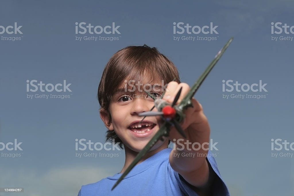 Kid outdoors with toy airplane stock photo