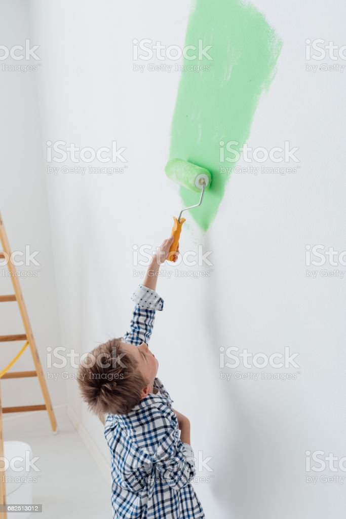 Kid painting a wall royalty-free stock photo