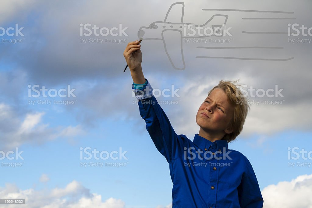 kid painting airplane. royalty-free stock photo