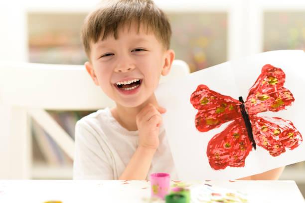 Kid Painting at Kindergarten stock photo