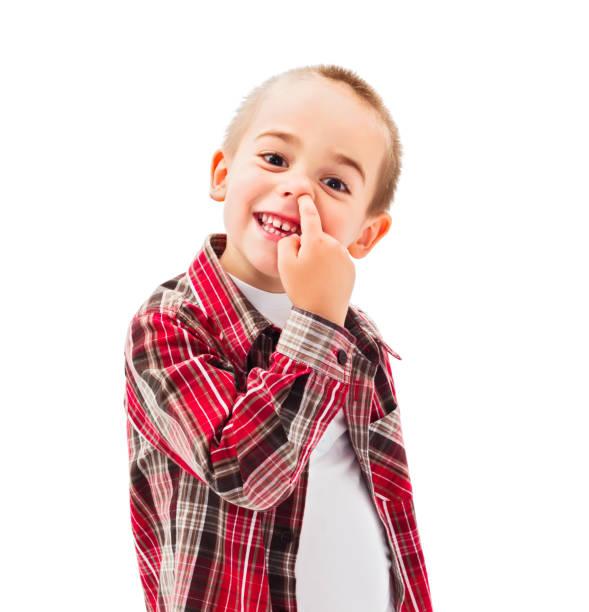 Kid picking Nose stock photo
