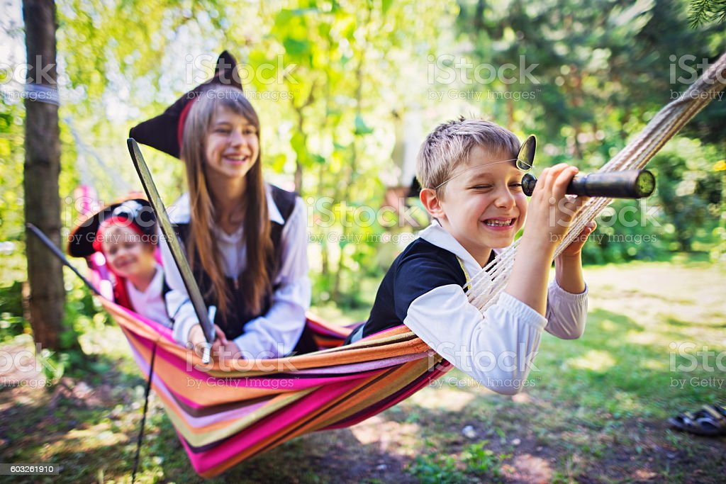 Kid pirates playing on a hammock boat stock photo