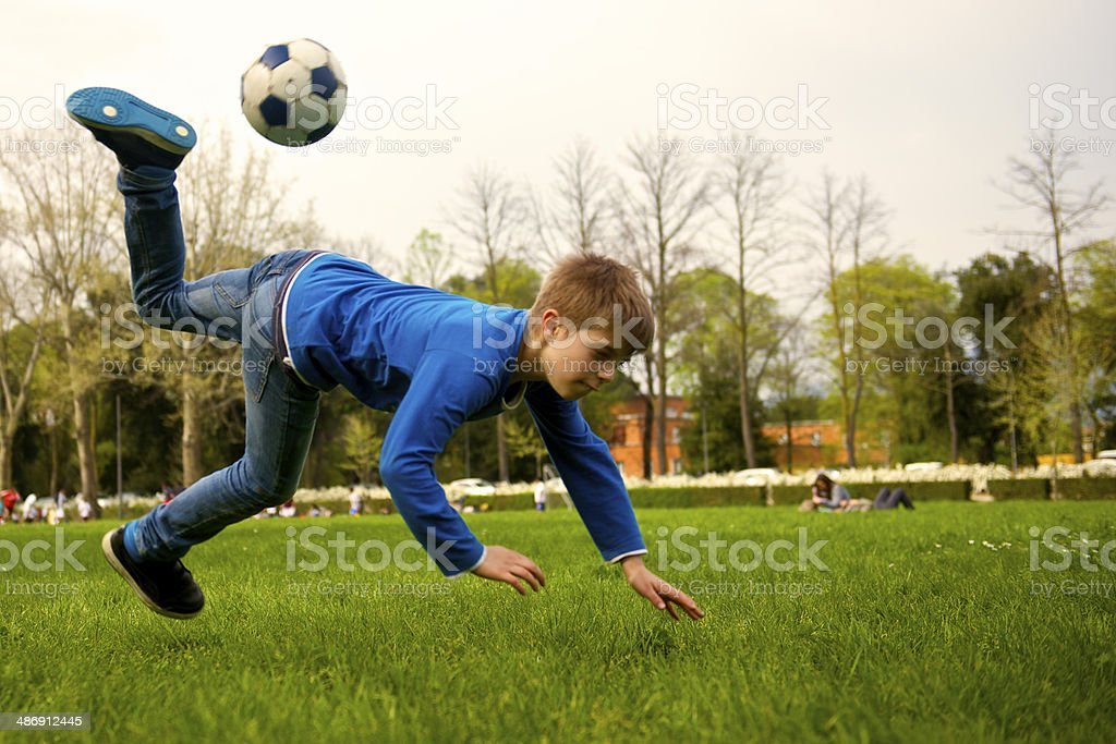 Kid play soccer at the park in Florence royalty-free stock photo