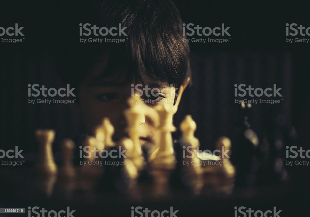 kid playing chess royalty-free stock photo