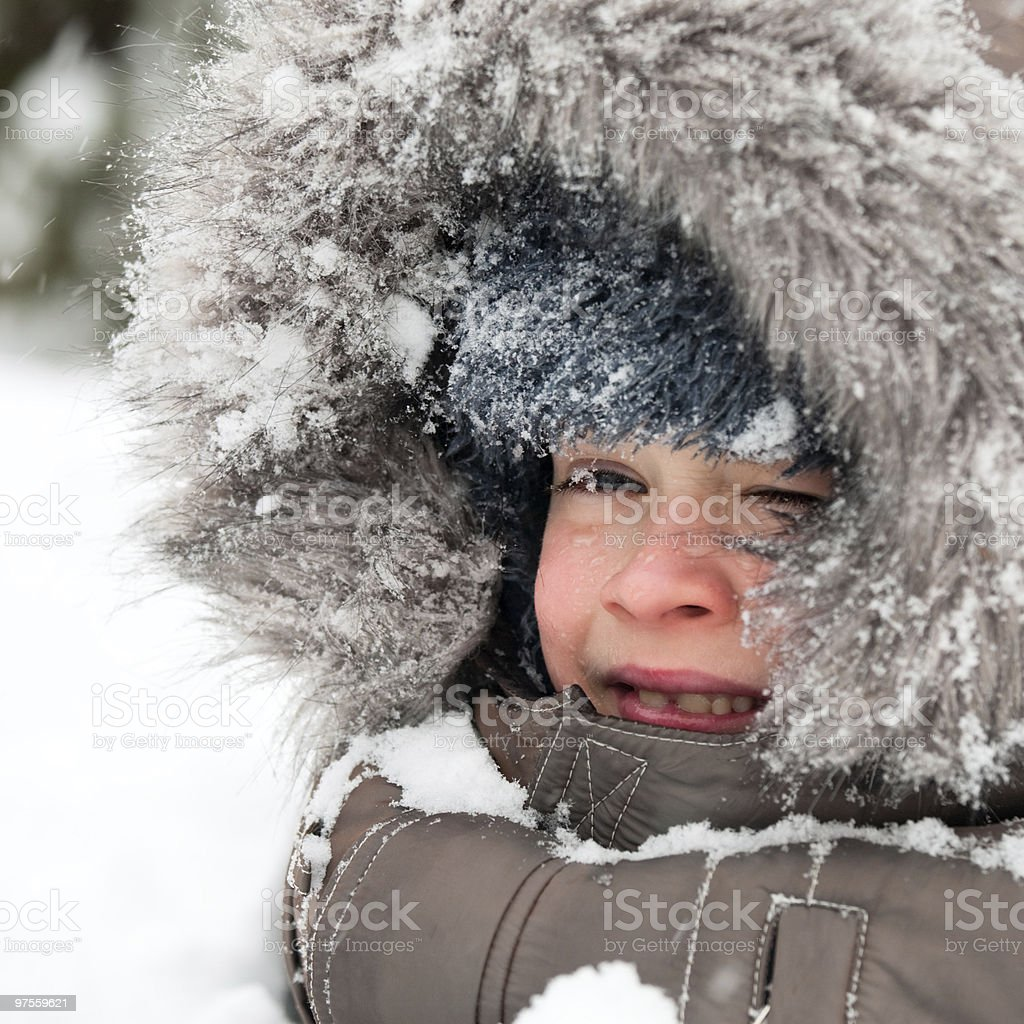 Kid playing in snow royalty-free stock photo