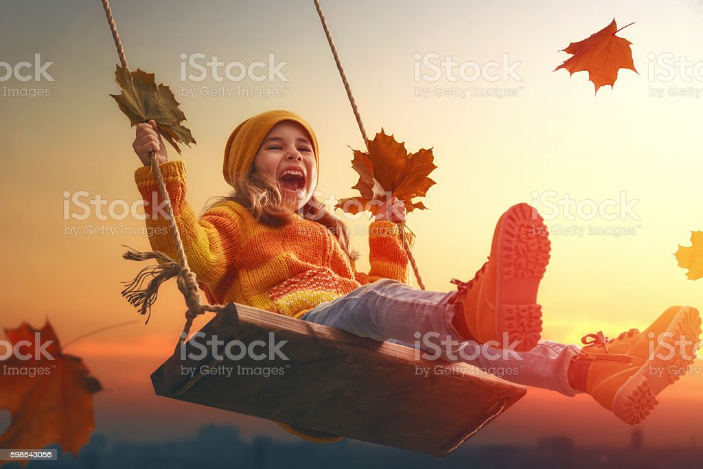 kid playing in the autumn stock photo