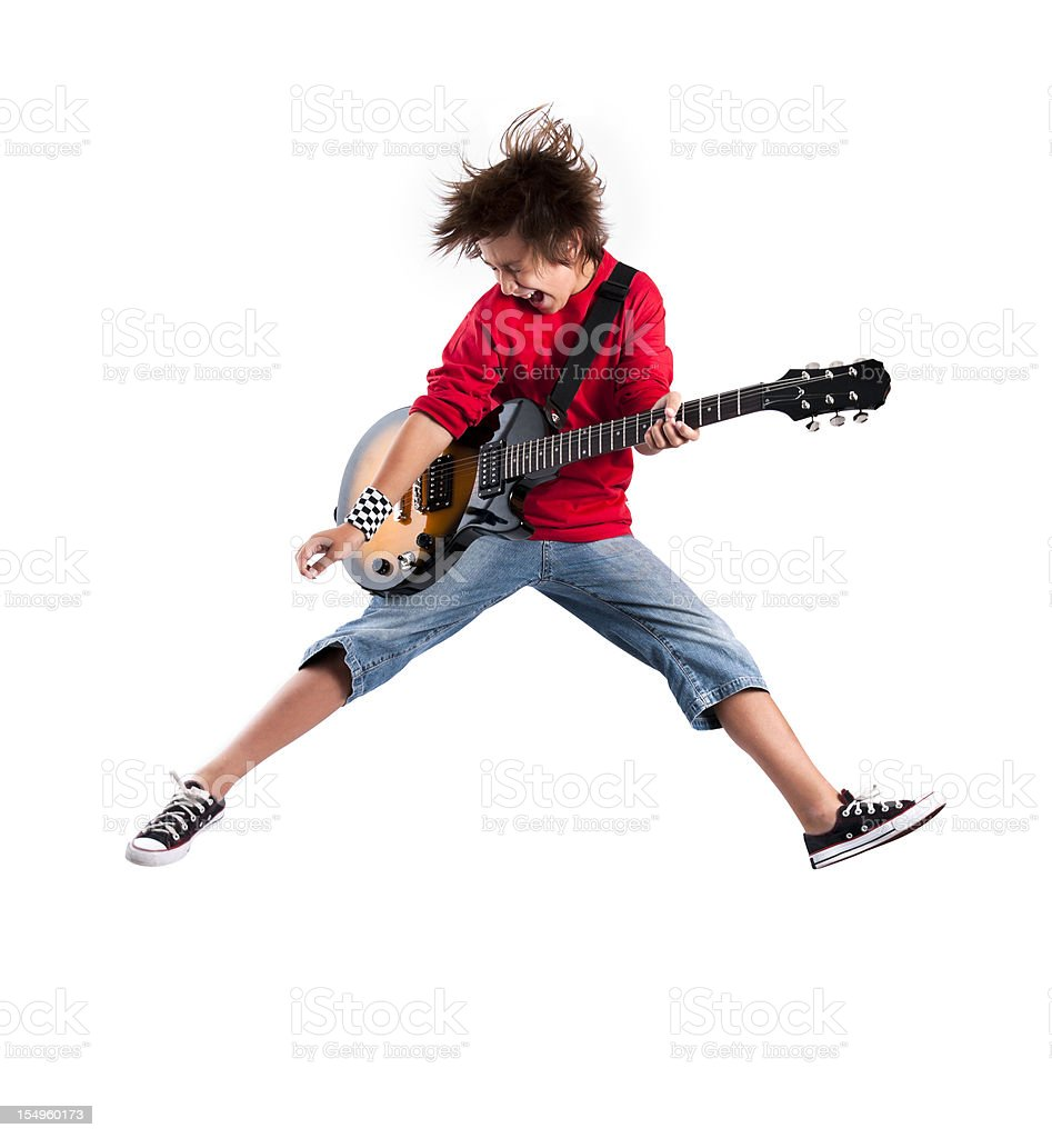 Kid playing the guitar while jumping in the air royalty-free stock photo
