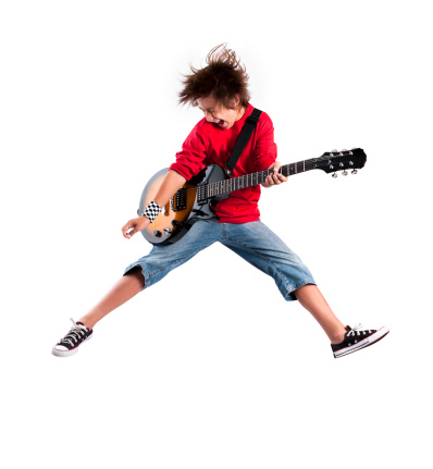 Jumping Guitarist with Clipping Path over a white background.