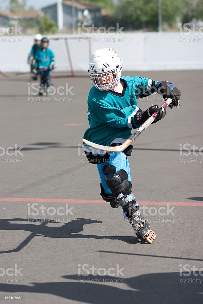 Kid Playing the Sport Street Hockey