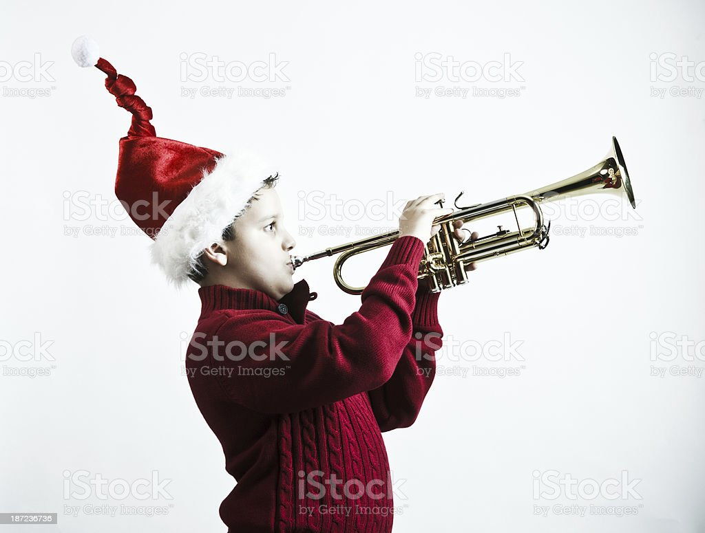 kid playing the trumpet stock photo