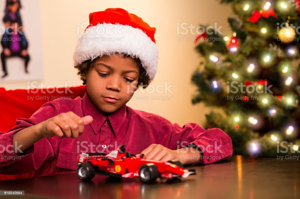 Kid playing with Christmas present. stock photo