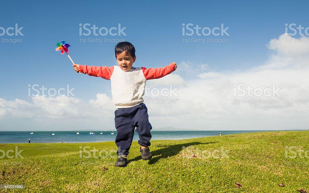 Kid Playing with Pinwheel stock photo