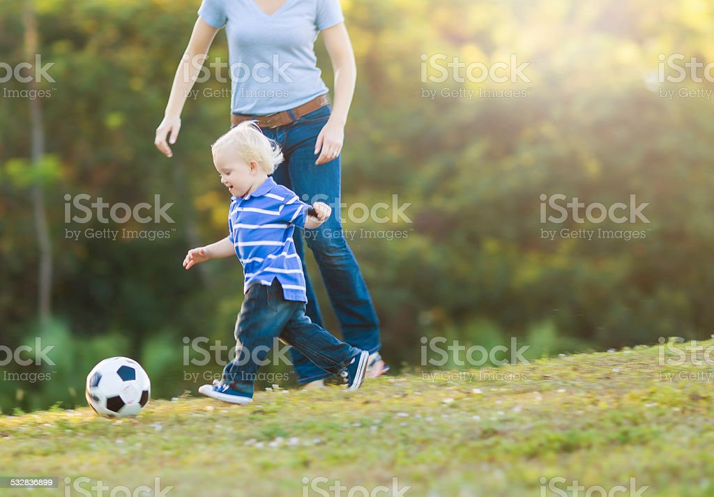 kid playing with soccer ball stock photo