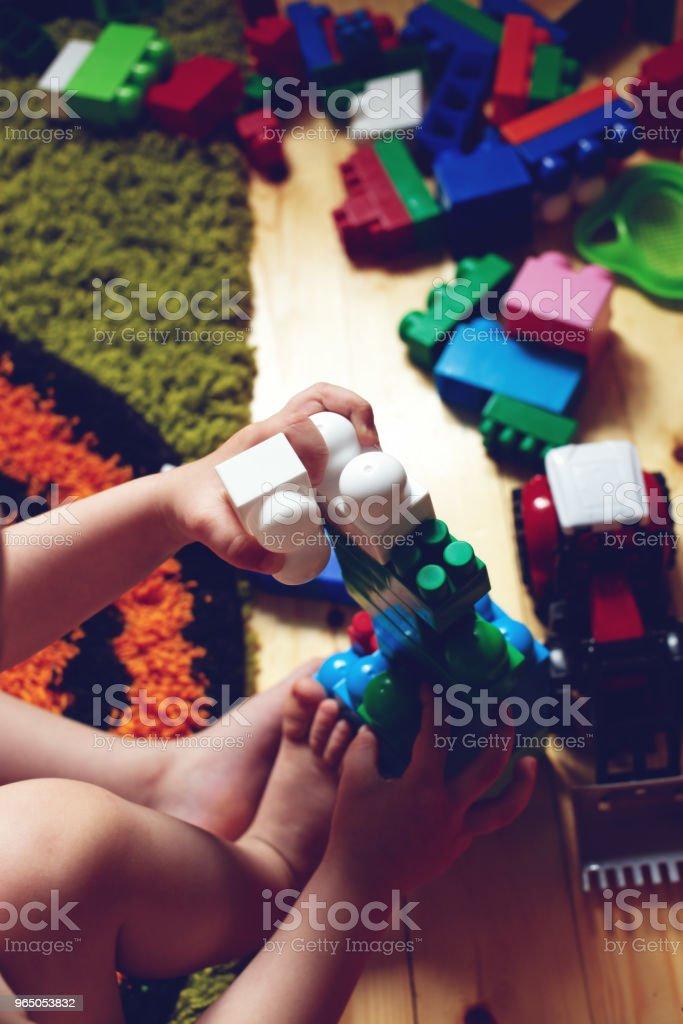 kid playing with toys zbiór zdjęć royalty-free