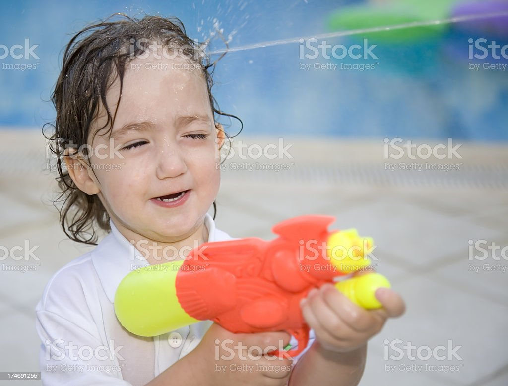 Kid playing with water gun got shot stock photo