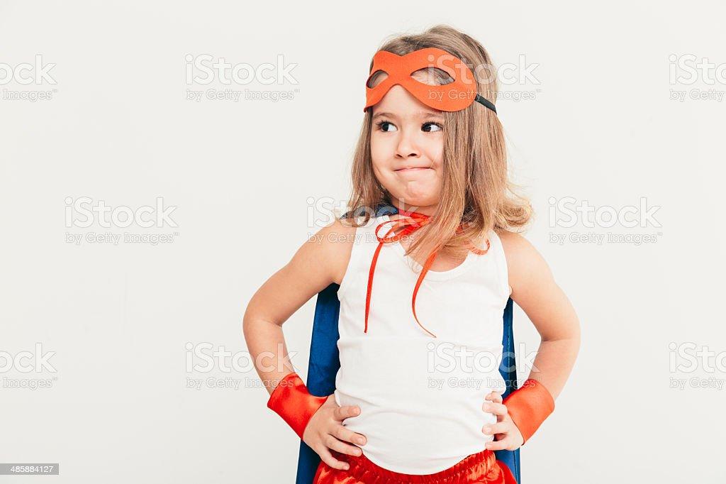 Kid portrait Funny little power super hero child (girl) in a blue raincoat. Superhero concept Active Lifestyle Stock Photo