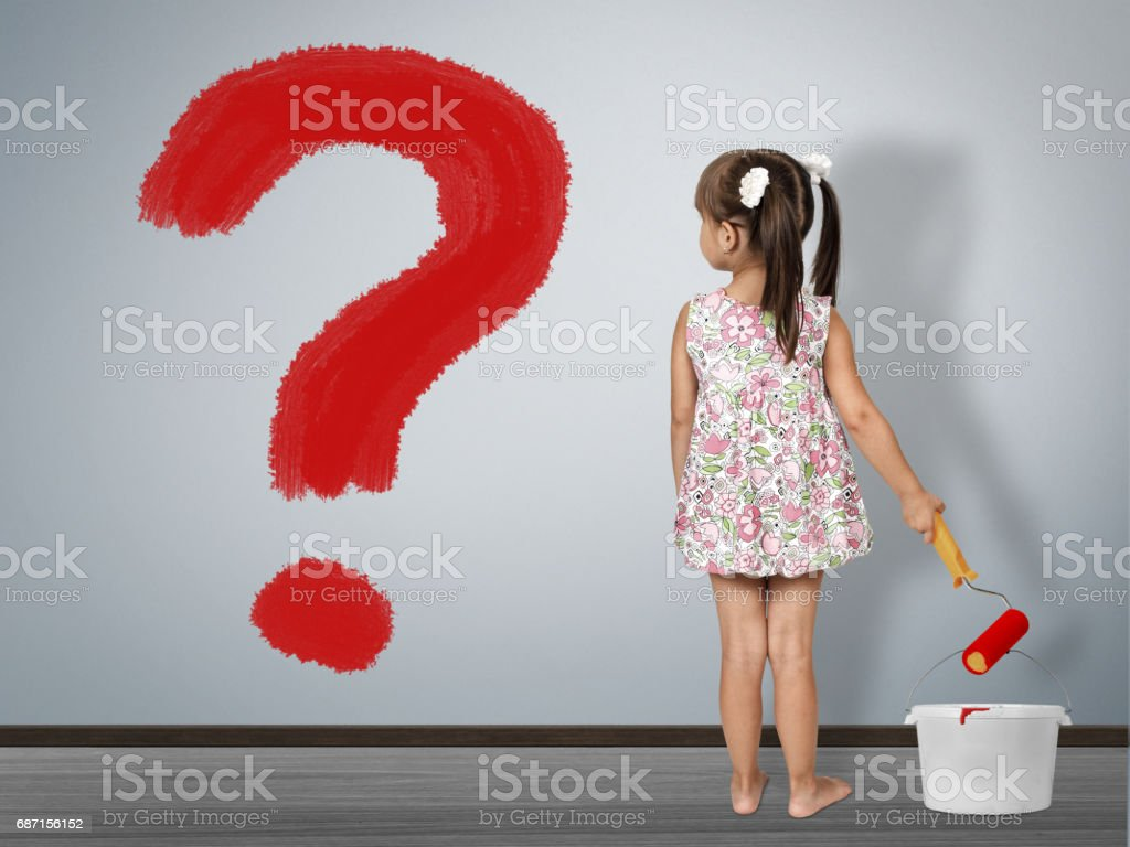 Kid question concept. Child girl draws question mark stock photo