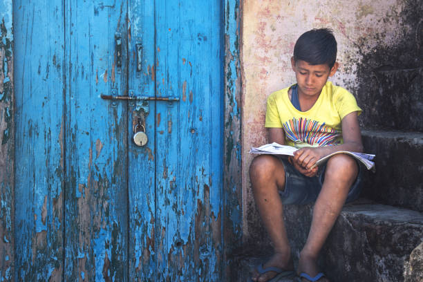 kid reading near locked door - poverty stock pictures, royalty-free photos & images