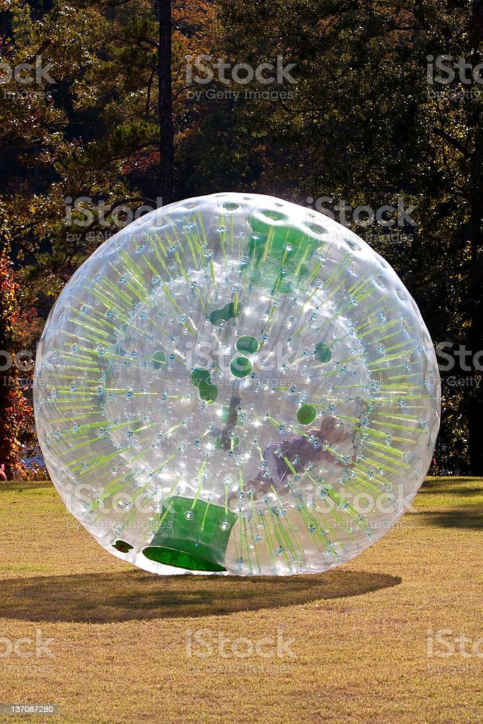Kid Rolling Inside Large Plastic Ball stock photo