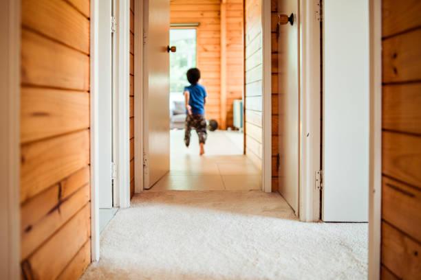 Kid running in corridor. stock photo