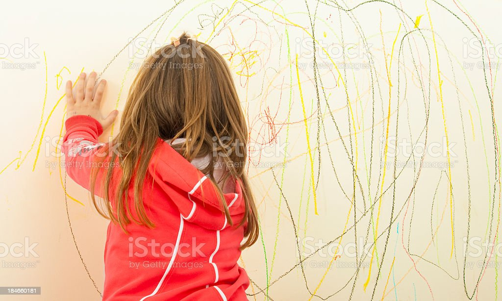 Kid Scribble on the Wall stock photo