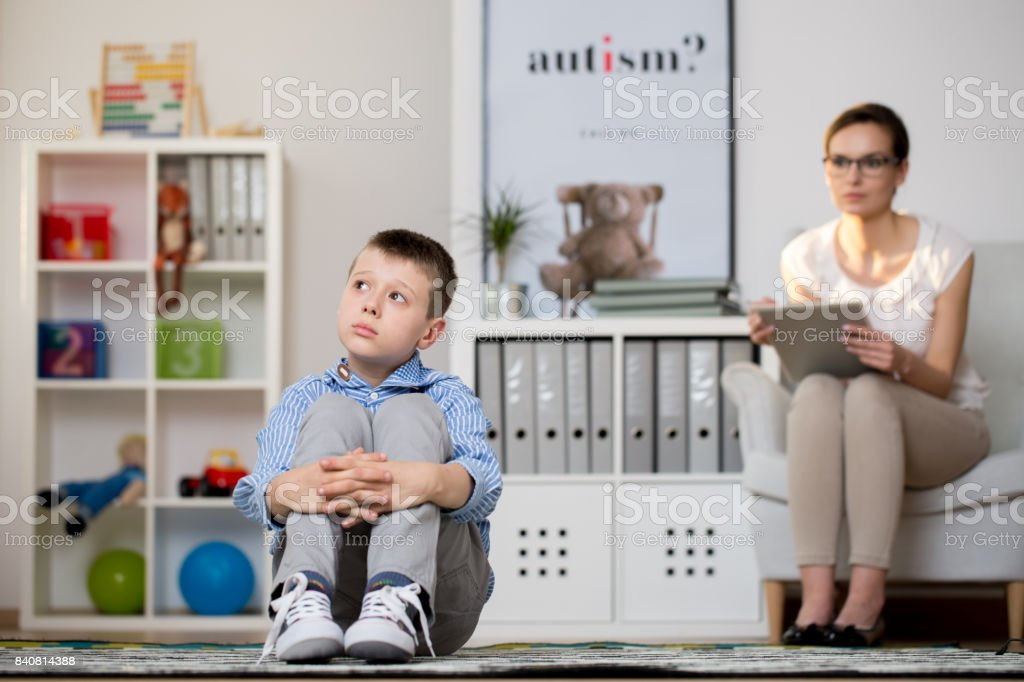 Kid sick of autism stock photo