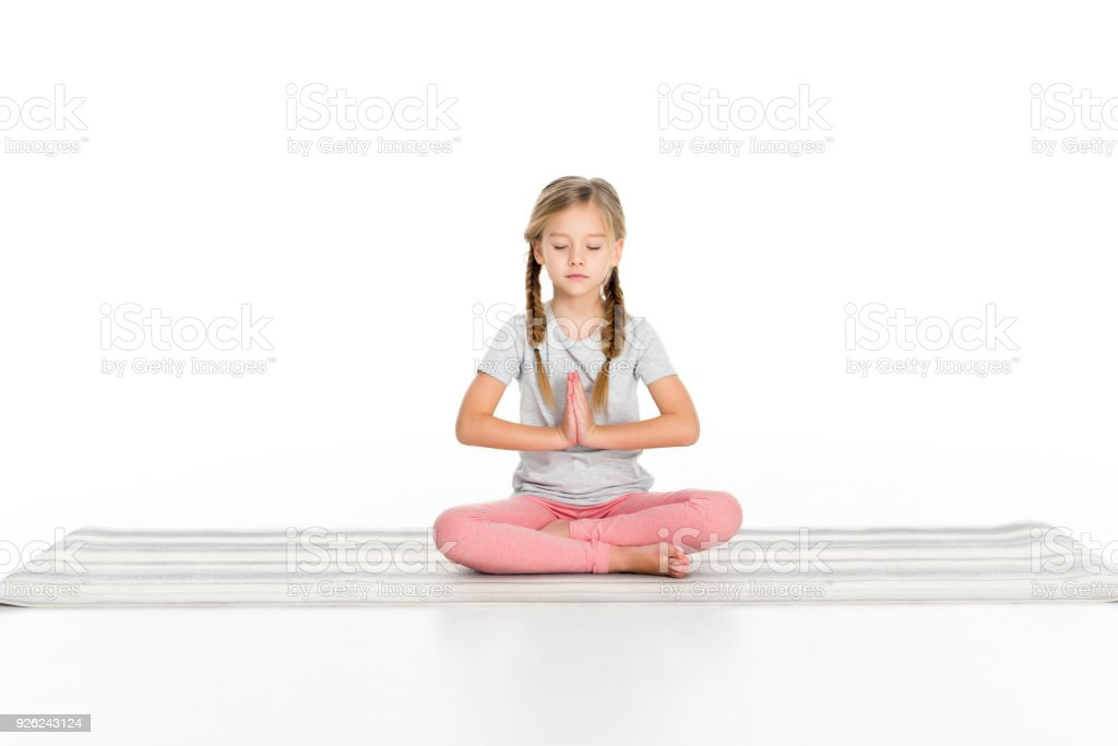 Kid Sitting In Lotus Position On Yoga Mat Isolated On White Stock Photo Download Image Now Istock