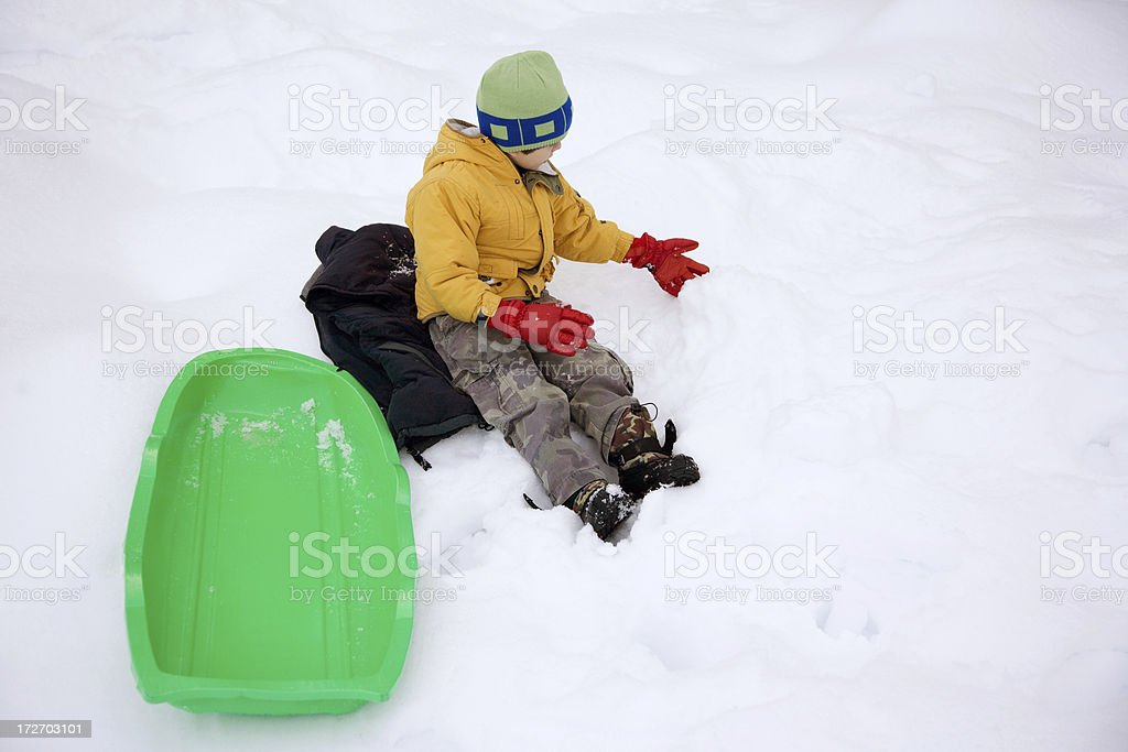 Kid Sitting On Snow royalty-free stock photo