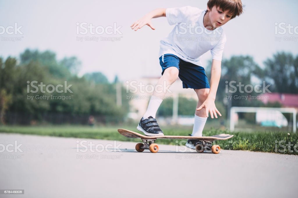 Kid skateboarder. stock photo